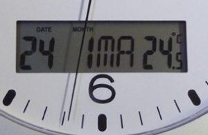 Pendule quartz à date  Ø30 cm